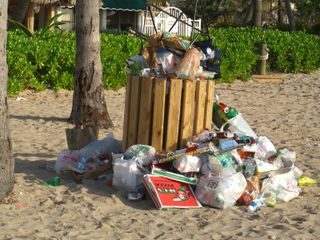 Overflowing garbage can July 5 2009
