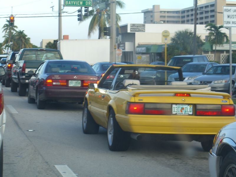 Woman litterer in yellow convertible 12-7-09