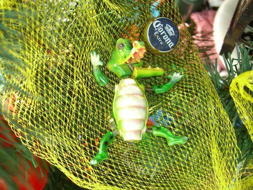 Unhinged alligator with Corona bottle cap on netting Litter