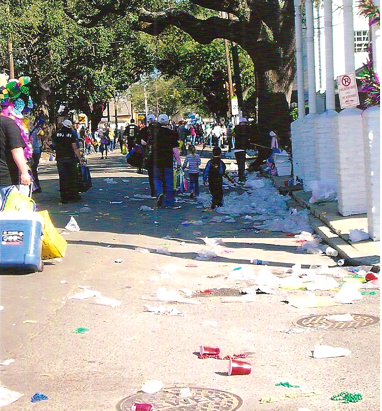Littered street Mardi Gras parade New Orleans on Magazine Street Feb 2010 by Beth Campbell