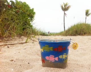 Windjammer Cigarette butt bucket painted by 9Muses on Beach