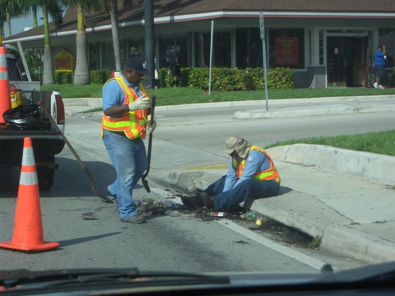 Maintenance men cleaning gutter#1