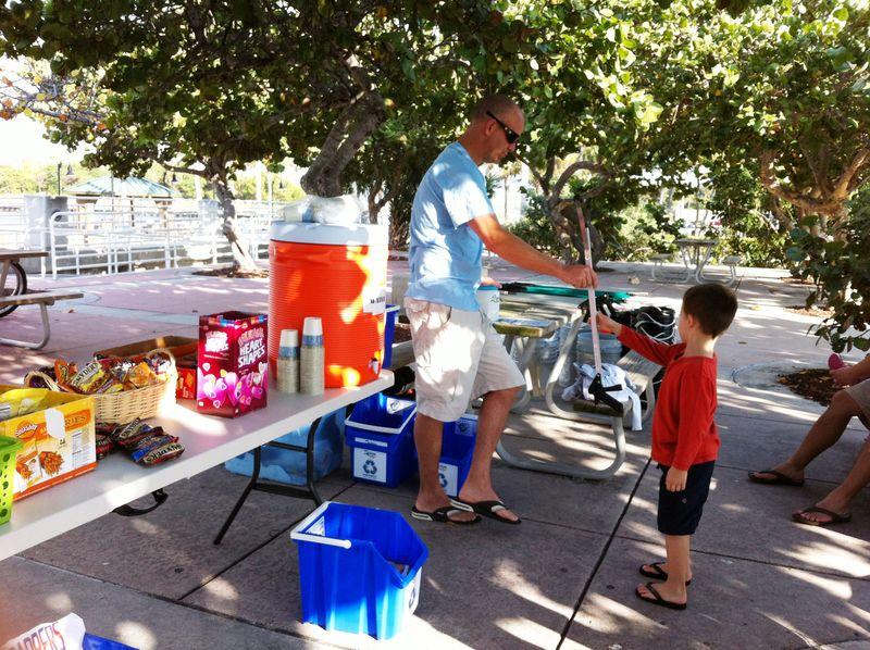 Mike Halasz of Sea Angels handing picker to kid