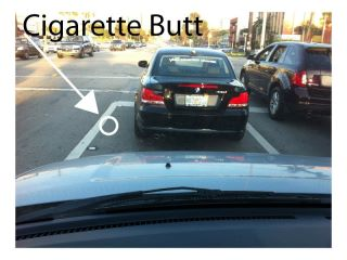 Car @ red light with cigarette butt type
