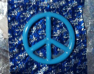 Closeup of peace sign from PPAL HB card to Eef