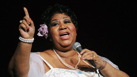 Aretha holding up finger
