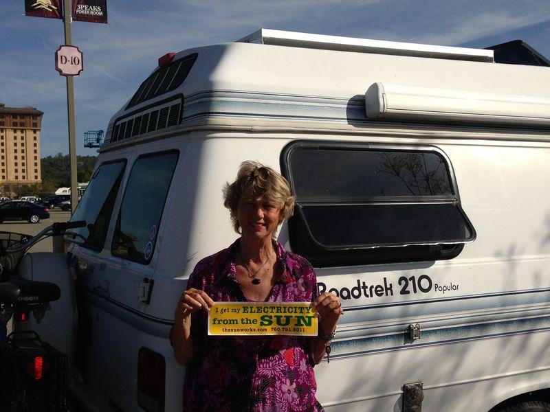 Sharon holding Solar Sign